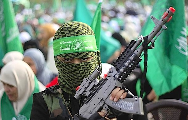 A Palestinian boy dressed as a member of the Ezzedine al-Qassam Brigades, the armed wing of Hamas, holds a toy gun as he attends celebrations for the 24th anniversary of its foundation in Gaza City on December 14, 2011. AFP PHOTO/MAHMUD HAMS (Photo credit should read MAHMUD HAMS/AFP/Getty Images)
